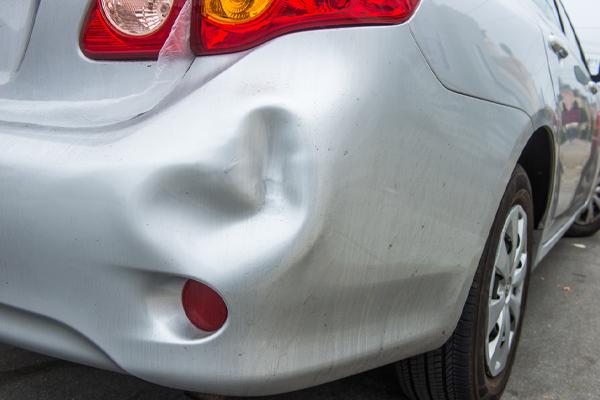 big dent in rear bumper